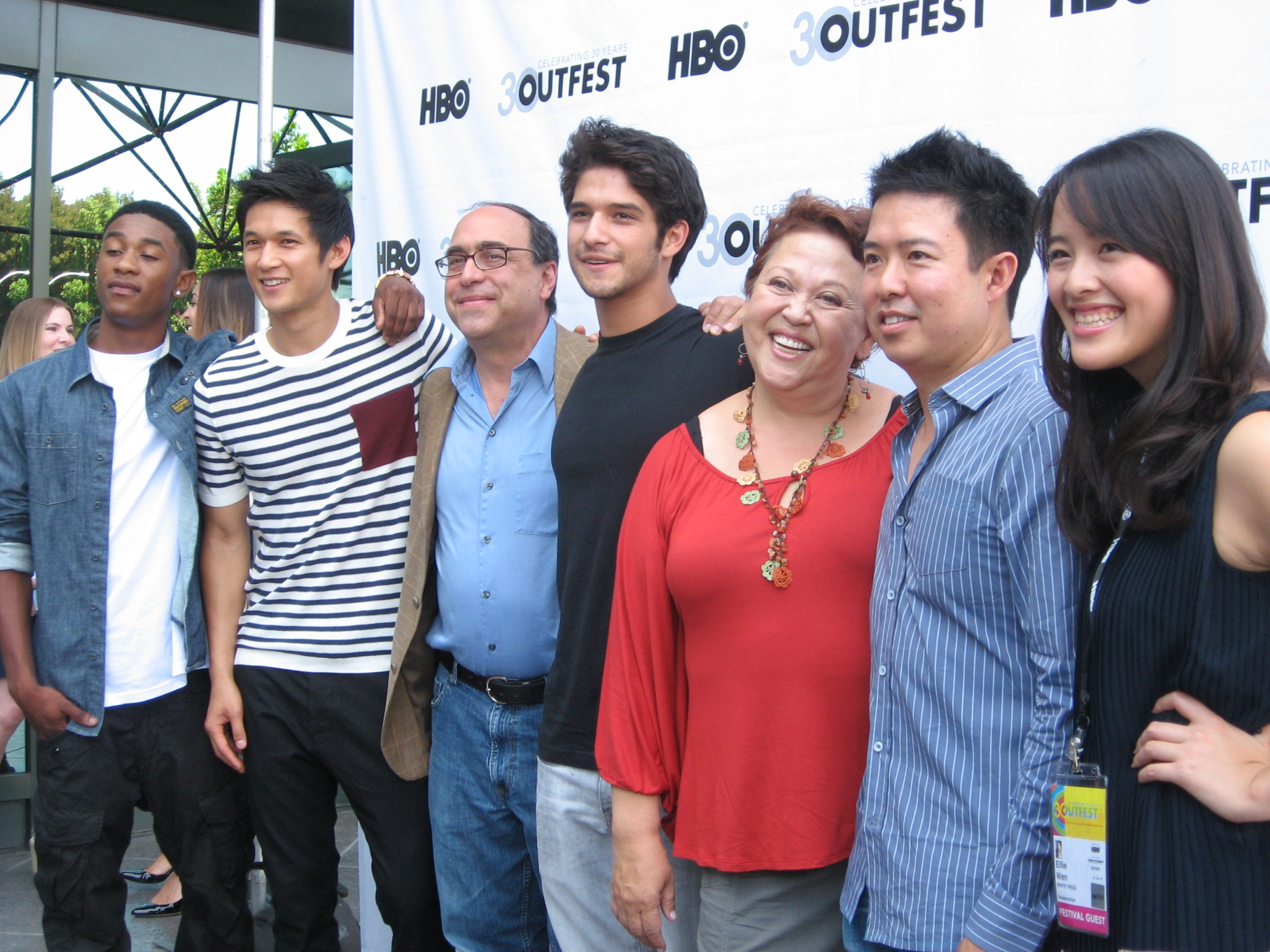 Cast and crew on the red carpet at the Outfest screening (Ellie Wen in foreground).